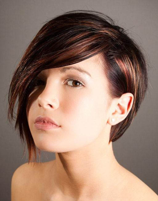 Short dark brown hair with copper red and blonde highlights.
